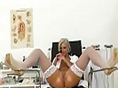 Blonde slut Nathaly Heaven wears stockings and latex uniform