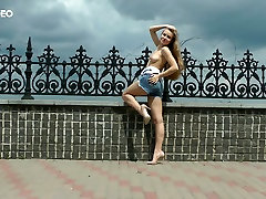 Salacious babe Angel is stripping and masturbating in broad daylight