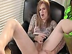 Inked shemale tugs and strokes her cock