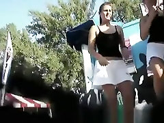Girl with white skirt showing upskirt