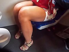 woman in miniskirt and high heels