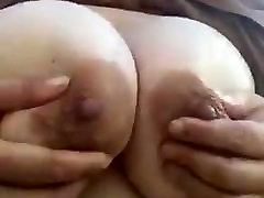 My MILF janda kongkek friend playing with her tits and nipples