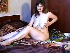 Mature and busty pale skin lady
