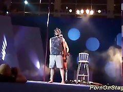 extreme fetish show on public show stage