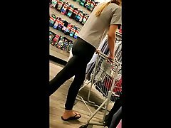 Candid tall thin blonde in yoga pants