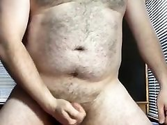 Hairy bear masturbating