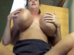 Big fake tits mature