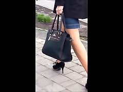 86 Woman with sexy legs in pantyhose and high heels