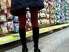 Red pantyhose in miniskirt.