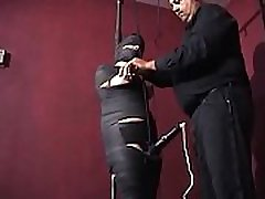 Mummified whore gets nipple tortured and vibrator in her pussy.WMV