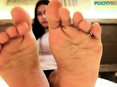 Beautiful ladyboy playing with her feet