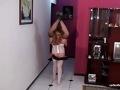 Smaller girl lifts bigger girl in a standing 69 No. 3