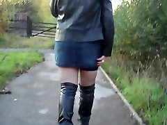 Black stockings, Suspender belt, Knee length boots,