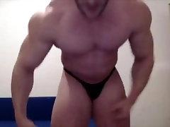 Bodybuilder Flexes His Muscles At Home - Radu