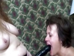 mature lesbian being skirt fucked with a strap on by her girlfriend
