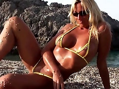 Blonde milf posing in micro kelly quern on the beach part 2