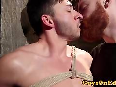 Suspended bdsm sub jerked by ginger maledom