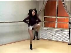 Girl in extremely short skirt and high heels dancing