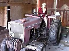Sexy girl masturbating on a tractor