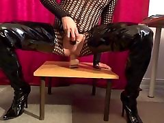 Slave slut rides huge dildo in crotch boots