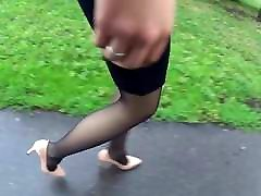 Following candid woman in black pantyhose and high heels