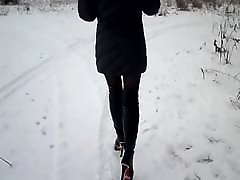 Walk on the snow in high heels in nylon pantyhose