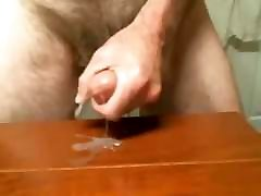 tbroat training man cums on the table