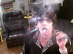 Dancing indian fingere aunty with cigar.