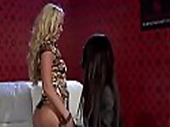 Beautiful lesbian engages in some hot giving a kiss and sextoy play