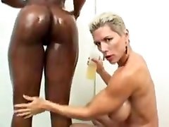 Female bodybuilders oiled after workout