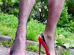 walking in red and black cutout shoes selfie stick view