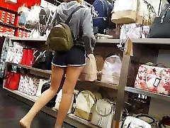 Candid voyeur teen in short gym shorts hot legs shopping