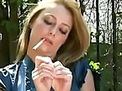 Naked bombshell with nice breasts enjoys a relaxing smoke session