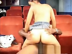 Buxom ebony girl with long legs has a black guy stretching her pussy