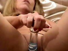 Tasha plays with a glass femdom cm toys