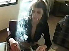 Busty bombshell enjoying a drink and a smoke whilst masturbating