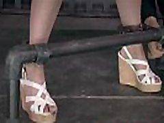 BDSM sub tied to poles before dildo play