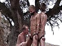 Restrained twinks punished by handjob master