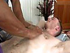 Sexy white hunk is enjoying a lusty massage from black stud