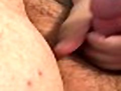 Brunette plays with big cock