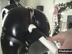 Christmas latex bondage.