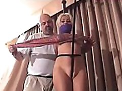Mature slut gets titillated whilst being strapped tight