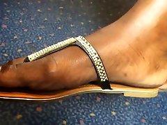 Ultra Close-Up of Beautiful Ebony Feet on the Train