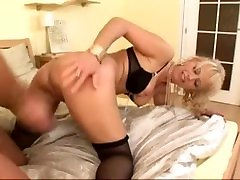 Hot granny gets a tube steak enema