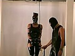 Perverted fetish scenes with stripped woman being roughly stimulated
