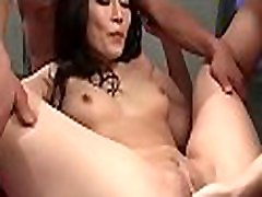 Asian babe with lovely tits gives magnetizing oral-stimulation
