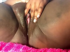 Ebony BBW slut watches porn and plays with her tight chocolate cunt.