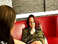 Beautiful lesbian engages in some sexy giving a kiss and dildo play