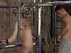 Dominant gay master toys his tied up slave and wanks him