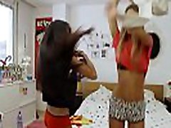 Two teen girls dancing at home